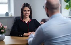 Beautiful brunette woman attending job interview. Beautiful brunette women attending job interview stock photo