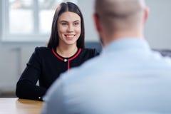 Beautiful brunette woman attending job interview. Beautiful brunette women attending job interview royalty free stock image