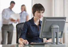Beautiful Brunette at Work Royalty Free Stock Photo