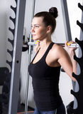 Beautiful brunette during workout in gym Royalty Free Stock Photography