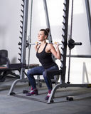 Beautiful brunette during workout in gym Royalty Free Stock Photos