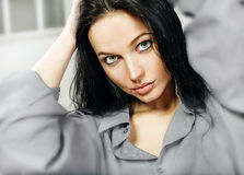 Beautiful brunette. Young blue eyes brunette beauty woman portrait Royalty Free Stock Photo