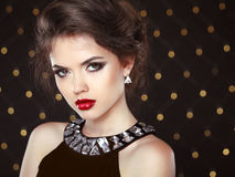 Beautiful brunette young woman. Fashion girl model over bokeh li Royalty Free Stock Images