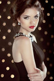 Beautiful brunette young woman. Fashion glam girl model over bok. Eh background Stock Images