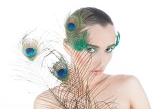 Beautiful brunette young woman with peacock style Stock Photography