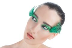 Beautiful brunette young woman with peacock style Stock Images