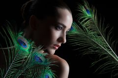 Beautiful brunette young woman with peacock style Royalty Free Stock Images