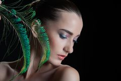 Beautiful brunette young woman with peacock style Stock Photo