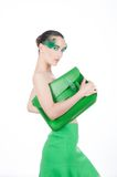 Beautiful brunette young woman with peacock style. Make-up and green satchel, green stylish garment, fashion model isolated on white Royalty Free Stock Photos