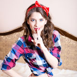 Beautiful brunette young woman pinup girl with blue eyes Royalty Free Stock Image