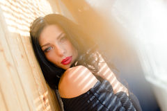 Beautiful brunette young woman with red lips looking at camera sensually Stock Image