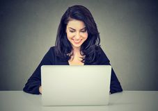Beautiful brunette young woman using a laptop computer Stock Photo