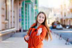 Beautiful brunette young woman walking on the street of city Stock Photos