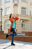 Beautiful brunette young woman walking on the street of city Royalty Free Stock Photography