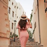 Stylish brunette woman walking in old town Royalty Free Stock Photo