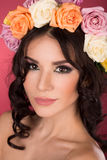 Beautiful brunette young woman with wreath of flowers studio shot pink background Royalty Free Stock Photography
