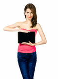 Beautiful brunnete woman holding laptop. Portrait of young beautiful brunnete woman holding laptop on white royalty free stock images