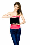Beautiful brunnete woman holding laptop Stock Images