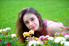 Beautiful Brunnete Woman Smelling Flowers Stock Photography