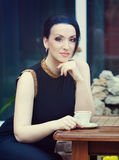 Beautiful brunnette drinking coffee Royalty Free Stock Images
