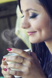 Beautiful brunnette drinking coffee Royalty Free Stock Photography
