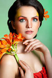 Beautiful brunnette with fantasy make-up stock image
