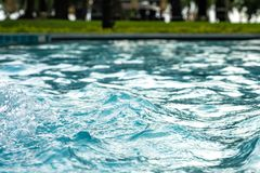 Blue clear fresh Water in pool. Spa massage background. royalty free stock photo