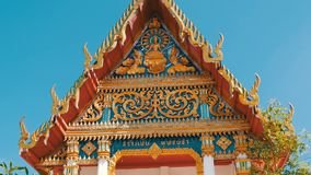 Beautiful Buddhist gilded temple with variety of ornaments and religious symbols. Beautiful Buddhist gilded temple with a variety of ornaments and religious stock footage