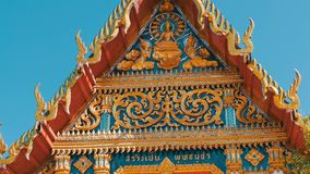 Beautiful Buddhist gilded temple with variety of ornaments and religious symbols. Beautiful Buddhist gilded temple with a variety of ornaments and religious stock video footage