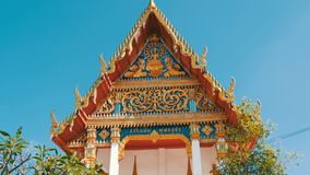 Beautiful Buddhist gilded temple with variety of ornaments and religious symbols. Beautiful Buddhist gilded temple with a variety of ornaments and religious stock video