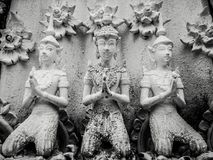 Beautiful buddhist sculpture hands clasped in prayer, detail of buddhist figures carved in Wat Sanpayangluang at Lamphun, Thailand royalty free stock image