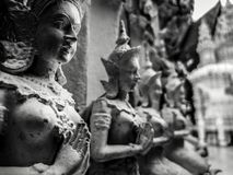 Beautiful buddhist sculpture hands clasped in prayer, detail of buddhist figures carved in Wat Sanpayangluang at Lamphun, Thailand stock photos