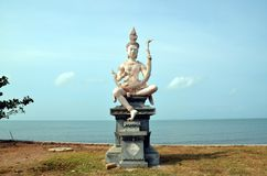 Beautiful buddhist statue. Embankment in Kep, Cambodia. Beautiful buddhist statue on the bank of the sea Stock Images