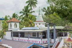 Beautiful buddhist temple on the territory of school. In Sri Lanka royalty free stock image