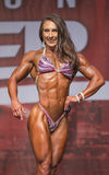 Beautiful and Buff Pro Fitness Competitor Royalty Free Stock Images
