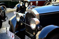 Blinking chrome headlichts of a Buick oldtimer stock image