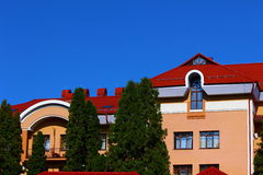 Beautiful building. Against the blue sky near the trees worth beautiful building Royalty Free Stock Photography