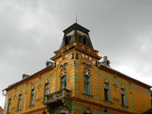 Beautiful building with amazing architecture on rainy day. Royalty Free Stock Images
