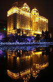 Beautiful building and artificial night lights. Reflected in water. Agricultural bank of China, Guangzhou Stock Photos