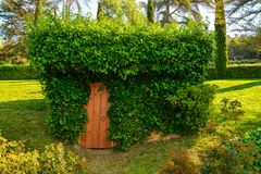 Beautiful building coverd with ivy. In the Santa Clotilde Gardens in Lloret de Mar stock image