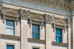 Beautiful building destail with historic facade, columns, pillar. Beautiful building destail with historic facade, pillars and descoration Royalty Free Stock Photo
