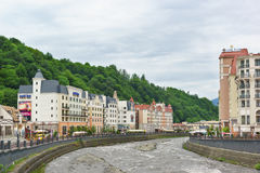 Beautiful building of the Park Inn hotel on the banks of the Mzymta river in the ski resort Royalty Free Stock Image