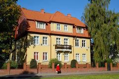 The beautiful building with a red tile roof on Kutuzov Street in Stock Image