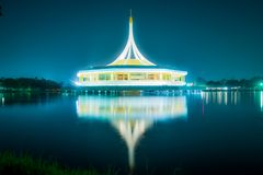 Beautiful building with reflex on the lagoon against blue sky in public park, Suanluang Rama 9. Beautiful building with reflex on the lagoon against blue sky in royalty free stock photos