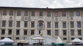 Beautiful building, University on Piazza dei Cavalieri. Pisa, Italy. Beautiful building of the University on Piazza dei Cavalieri decorated with sculptures of Stock Photos