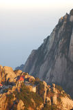 Beautiful buildings in the mountain of HuangShan. Beautiful buildings with red tops in the sunshine of sunset in HuangShan stock image