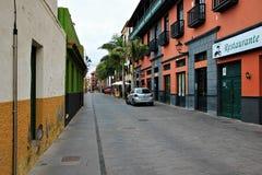 Beautiful buildings in a street in Puerto de la Cruz in Tenerife Canary Islands, Spain, Europe. Beautiful colorful buildings in a street in the old town of stock image