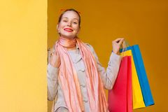 The beautiful bun haired woman in casual clothing with shopping Stock Photo