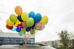 Beautiful bunch of colorful balloons fixed to the roof of the ca Royalty Free Stock Photo