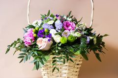 Bunch in basket. Beautiful bunch of different flowers in basket, selective focus and blurred background Stock Photos